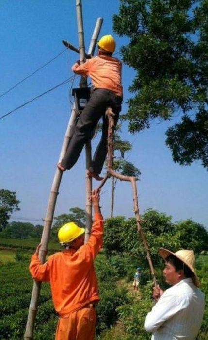 the guy on the right doesn't have a hard hat!